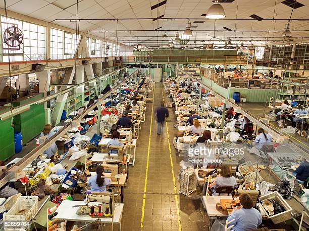 people working in a shoe factory - textile industry stock pictures, royalty-free photos & images