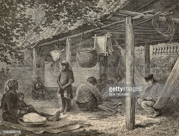 People working in a typical native house of British Guyana at the 1886 Colonial and Indian Exhibition London United Kingdom engraving from The...