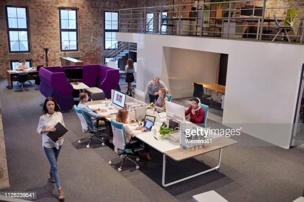 people working in big modern office - coworking stock-fotos und bilder