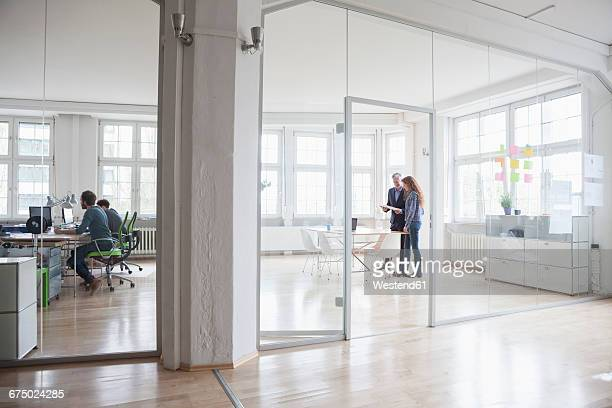 People working in bright office