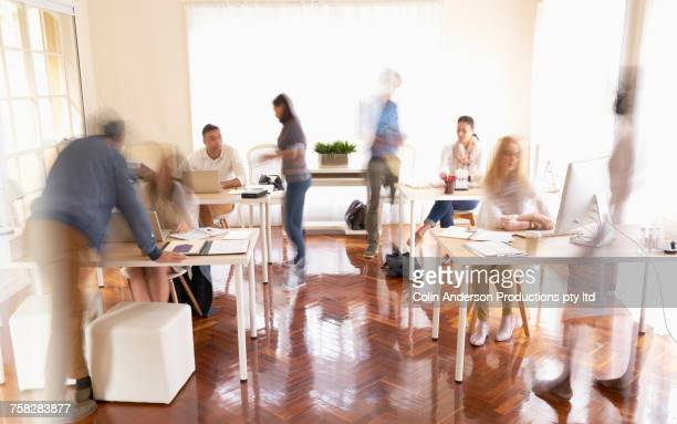 people working in busy office - motion blur stock photos and pictures