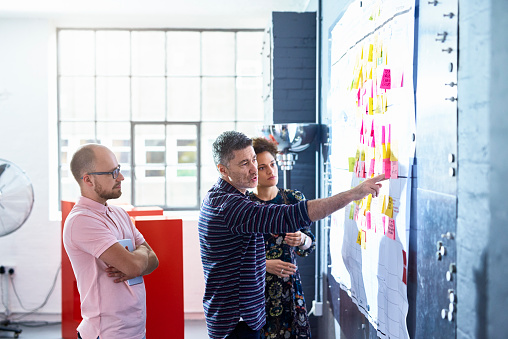 People working in creative studio - gettyimageskorea