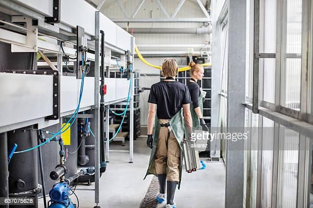 People working in fish farm
