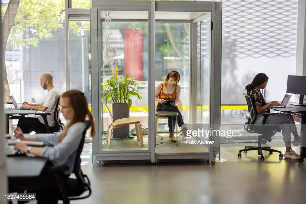 people working in hybrid office space - coworking stock pictures, royalty-free photos & images