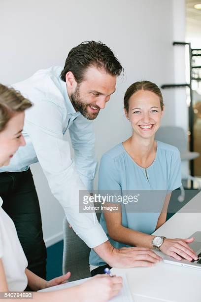 People working in meeting room