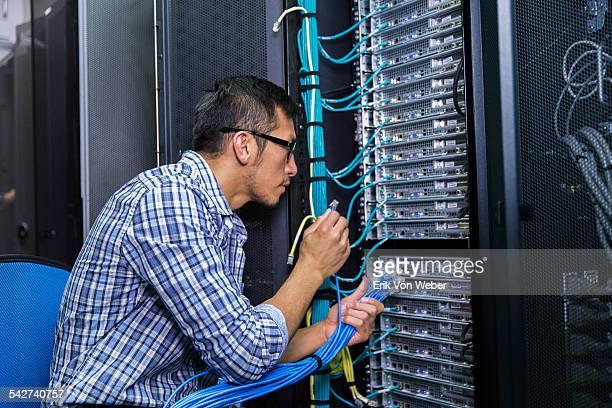 people working in modern server room