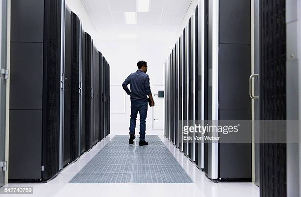 people working in modern server room - network server stock pictures, royalty-free photos & images