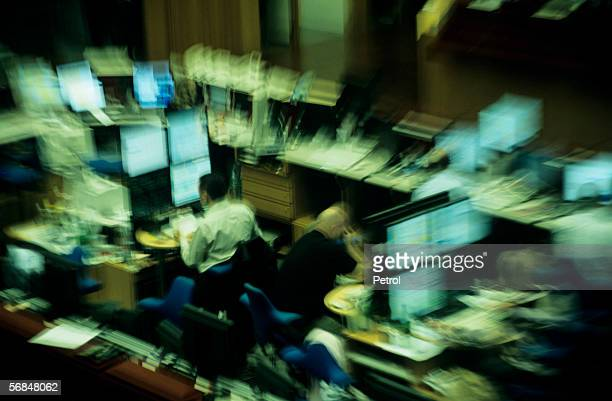 people working in office, elevated view - bull market stock pictures, royalty-free photos & images
