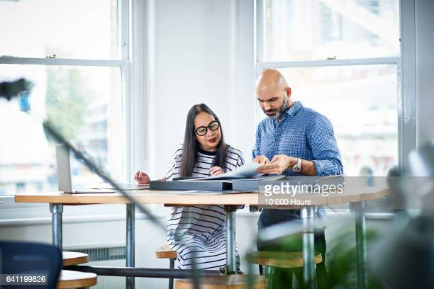 people working in office. - business casual stock pictures, royalty-free photos & images