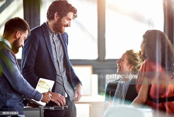 people working in office - employee engagement stock pictures, royalty-free photos & images