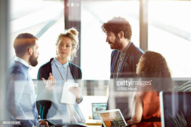 people working in office - millennial generation stock pictures, royalty-free photos & images