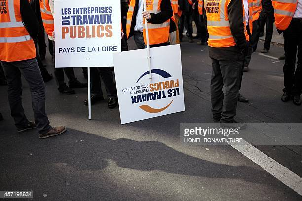 works sector hold signs reading stock photos and pictures getty images