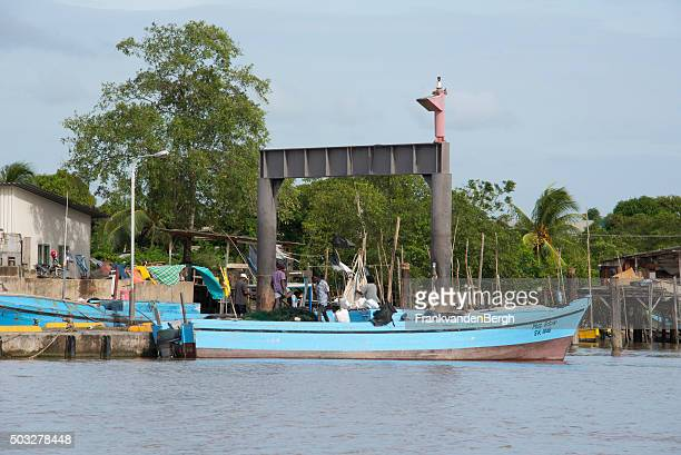 People working on a fishing  boat