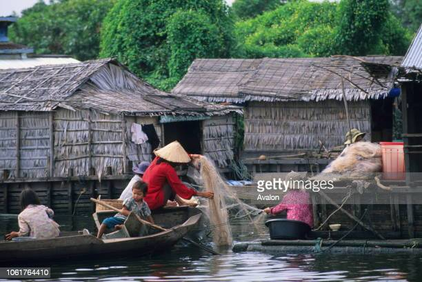 People working on fishing net in the floating village on Tonle Sap Lake near Siem Reap in Cambodia