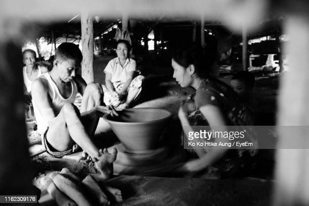 people working on pottery wheel - ko ko htike aung stock pictures, royalty-free photos & images