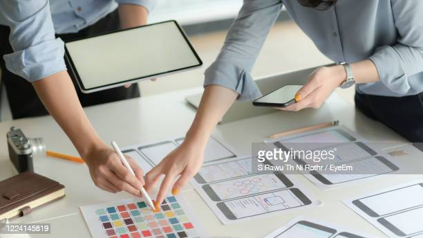 people working on table - graphical user interface stock pictures, royalty-free photos & images