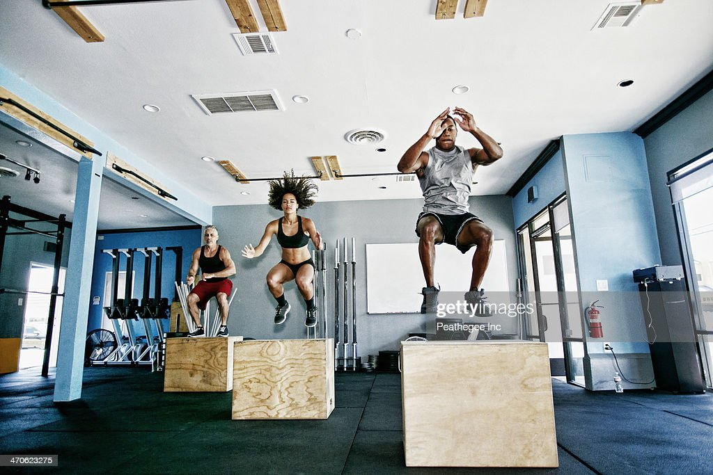 People working out in gym : Stock Photo