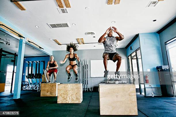 people working out in gym - cross training stock pictures, royalty-free photos & images