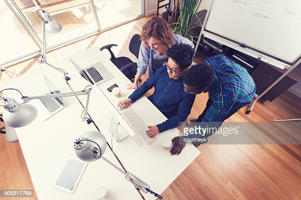 3 people working together in a small business office