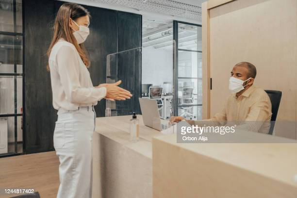people working with mask during the covid-19 - reopening stock pictures, royalty-free photos & images