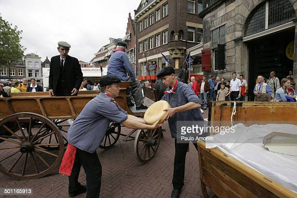 People works at traditional cheese market in Gouda south Netherlands. The Cheese Market with over 300 years, where people negotiate the prices with...
