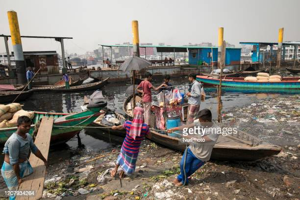 People works in the Buriganga river in Dhaka Bangladesh on March 21 2020 The chemical waste of mills and factories household waste eventually makes...