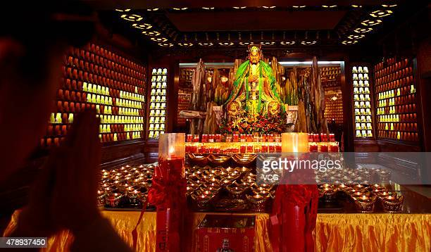 People worship God of wealth during a celebration for the birthday of Longwuye at Nanshan Buddhist Culture Park on June 28 2015 in Sanya Hainan...