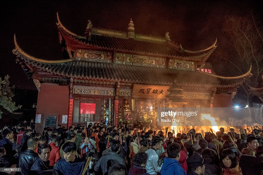 People worship on Chinese Lunar New Year's Eve on February 19, 2015 in Hefei, China. The Spring Festival will be celebrated February 18-24.