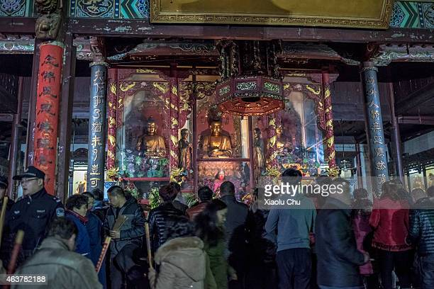 People worship on Chinese Lunar New Year's Eve on February 19 2015 in Hefei China The Spring Festival will be celebrated February 1824
