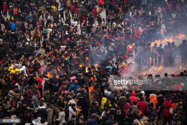 People worship the God of Fortune at the Guiyuan Temple on February 1 2017 in Wuhan Hubei province China The fifth day in the lunar new year is...