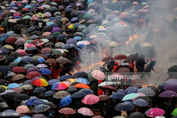 People worship the God of Fortune at the Guiyuan Temple on February 20 2018 in Wuhan Hubei province China The fifth day in the lunar new year is...