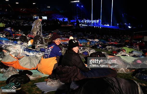 People wrap themselves with sleeping bag and thermal blankets during the ANZAC Dawn service in Canakkale, Turkey on April 25, 2016. Thousands of...
