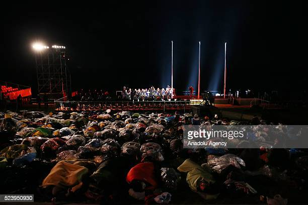 People wrap themselves with sleeping bag and thermal blankets during the ANZAC Dawn service in Canakkale Turkey on April 25 2016 Thousands of...