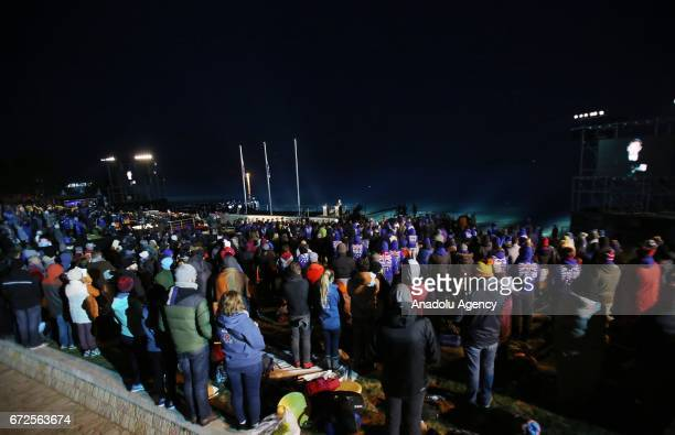 People wrap themselves with sleeping bag and thermal blankets during the ANZAC Dawn service in Canakkale Turkey on April 25 2017 Thousands of...