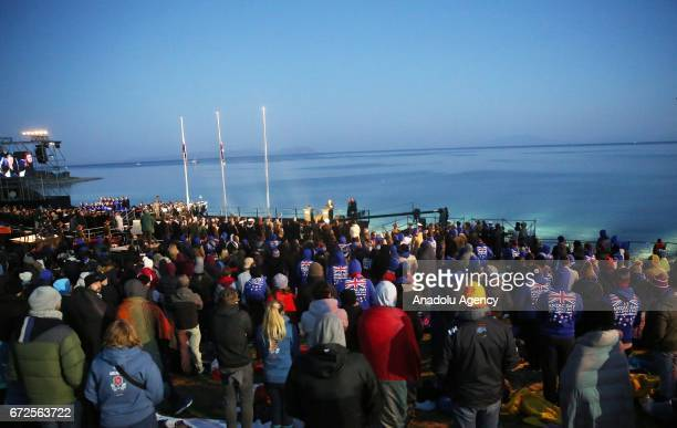People wrap themselves with sleeping bag and thermal blankets during the ANZAC Dawn service in Canakkale, Turkey on April 25, 2017. Thousands of...