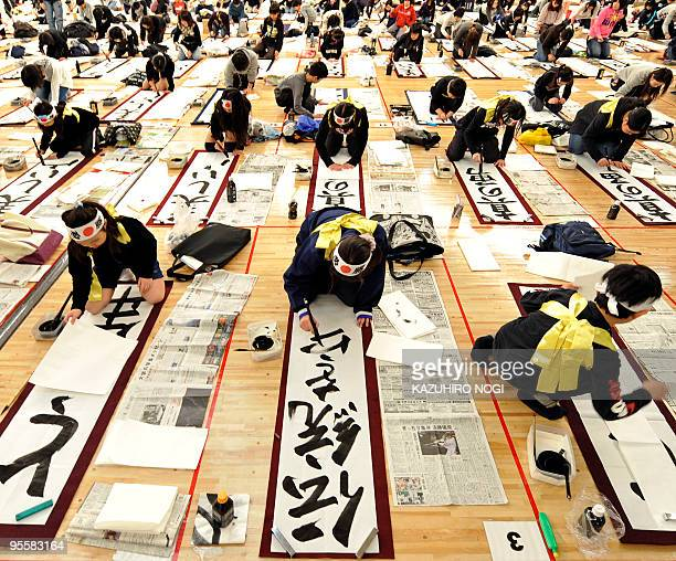 People write calligraphy during the 46th annual calligraphy contest in Tokyo on January 5 2010 to help mark the start of the new year A total of 3300...