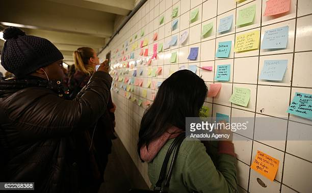 People write their messages on selfstick paper as a part of Voice Actor Matthew Chavez's public art project named 'Subway Therapy' at the 6th Avenue...