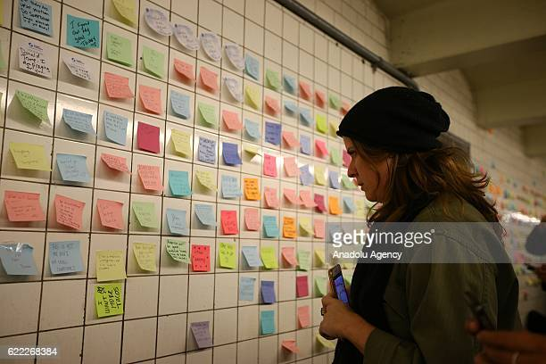 People write their messages on selfstick paper as a part of Voice Actor Matthew Chavez's public art project named Subway Therapy at the 6th Avenue...