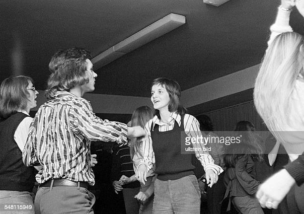 People, young couple in a disco, dancing, aged 16 to 20 years -