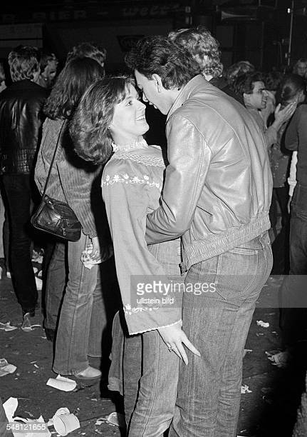 People, young couple in a disco, dancing, embracement, aged 18 to 25 years -