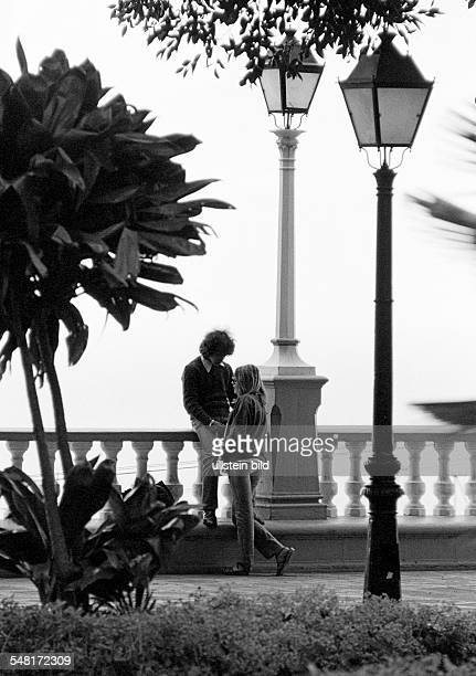 People, young couple stands close together, affection, idyllic, lanterns, balusters, aged 17 to 20 years, Spain, Canary Islands, Canaries, Tenerife,...