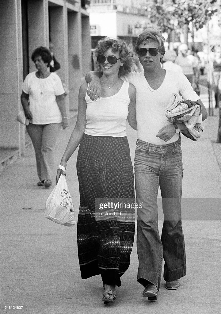 people, young couple, walking, embracement, aged 18 to 25 years, Spain, Balearic Islands, Majorca - 10.10.1978 : News Photo
