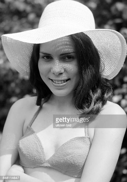 people young girl in a bikini with straw hat portrait aged 18 to 22 years Gaby Gabi