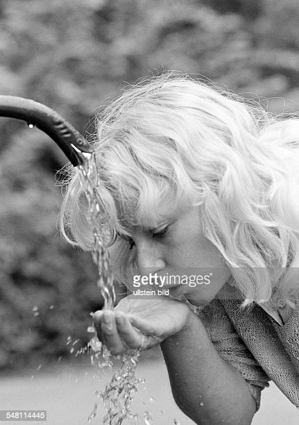 people young woman drinks water from a spring refreshment cooling portrait blond aged 30 to 35 years Elisabeth