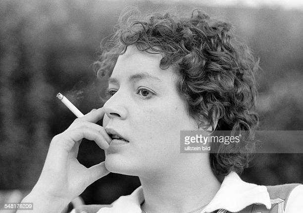 people young woman holds a cigarette in her hand portrait aged 23 to 28 years Monika
