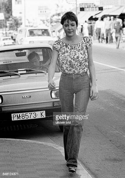 people young woman on the pavement blouse jeans trousers parking car aged 22 to 28 years Spain Balearic Islands Majorca Palma de Majorca