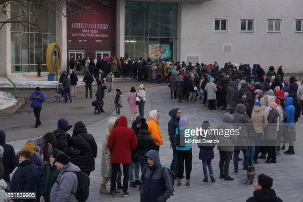 Peoplel, partly wearing face masks to protect themselves against the coronavirus , line up to the Body Worlds anatomic exhibition at the territory of...