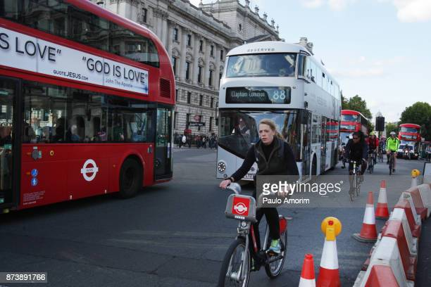 Peopler ride bicycle on the street in London