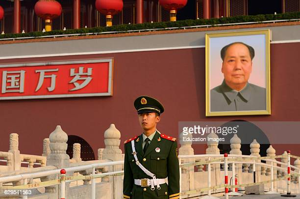 Peoples Armed Police officer with portrait of Mao Zedong at Tiananmen Gate of Heavenly Peace Beijing