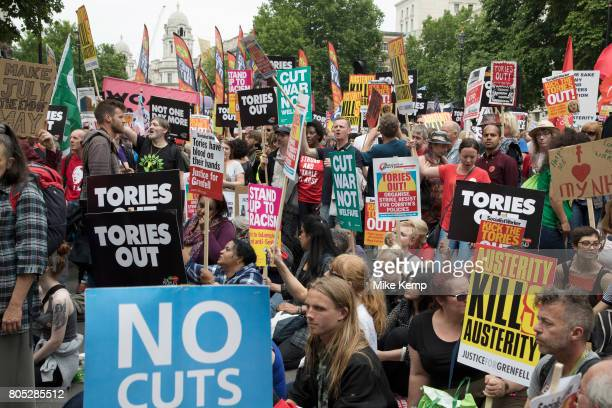 Peoples Assembly National Demonstration Against Theresa May and Austerity Not One Day More Tories Out arrives at Downing Street where protesters sit...